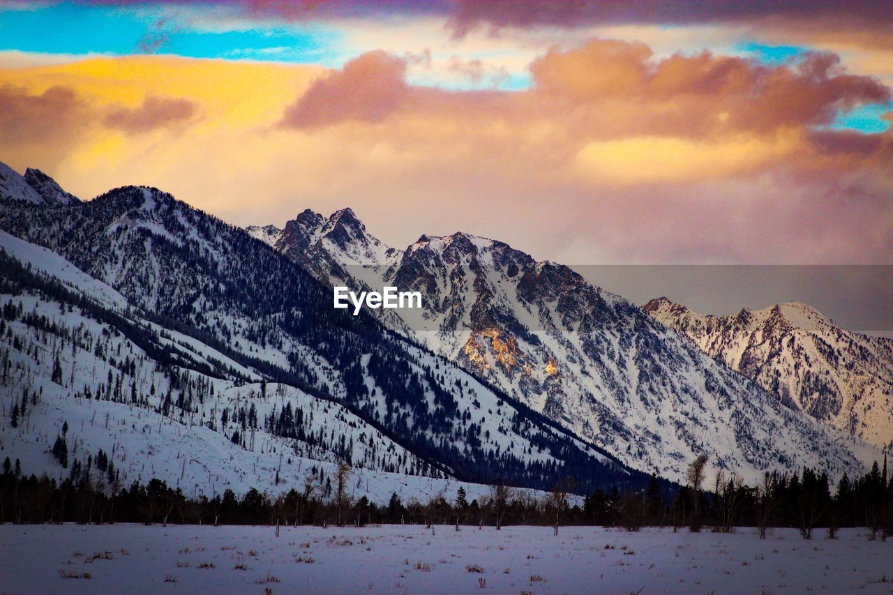 mountain, snow, winter, cold temperature, nature, scenics, sky, beauty in nature, mountain range, tranquil scene, cloud - sky, tranquility, landscape, weather, no people, outdoors, snowcapped mountain, day, tree