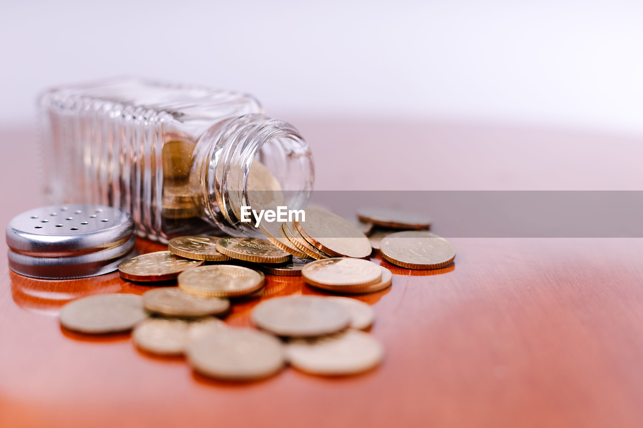 CLOSE-UP OF COINS IN CONTAINER