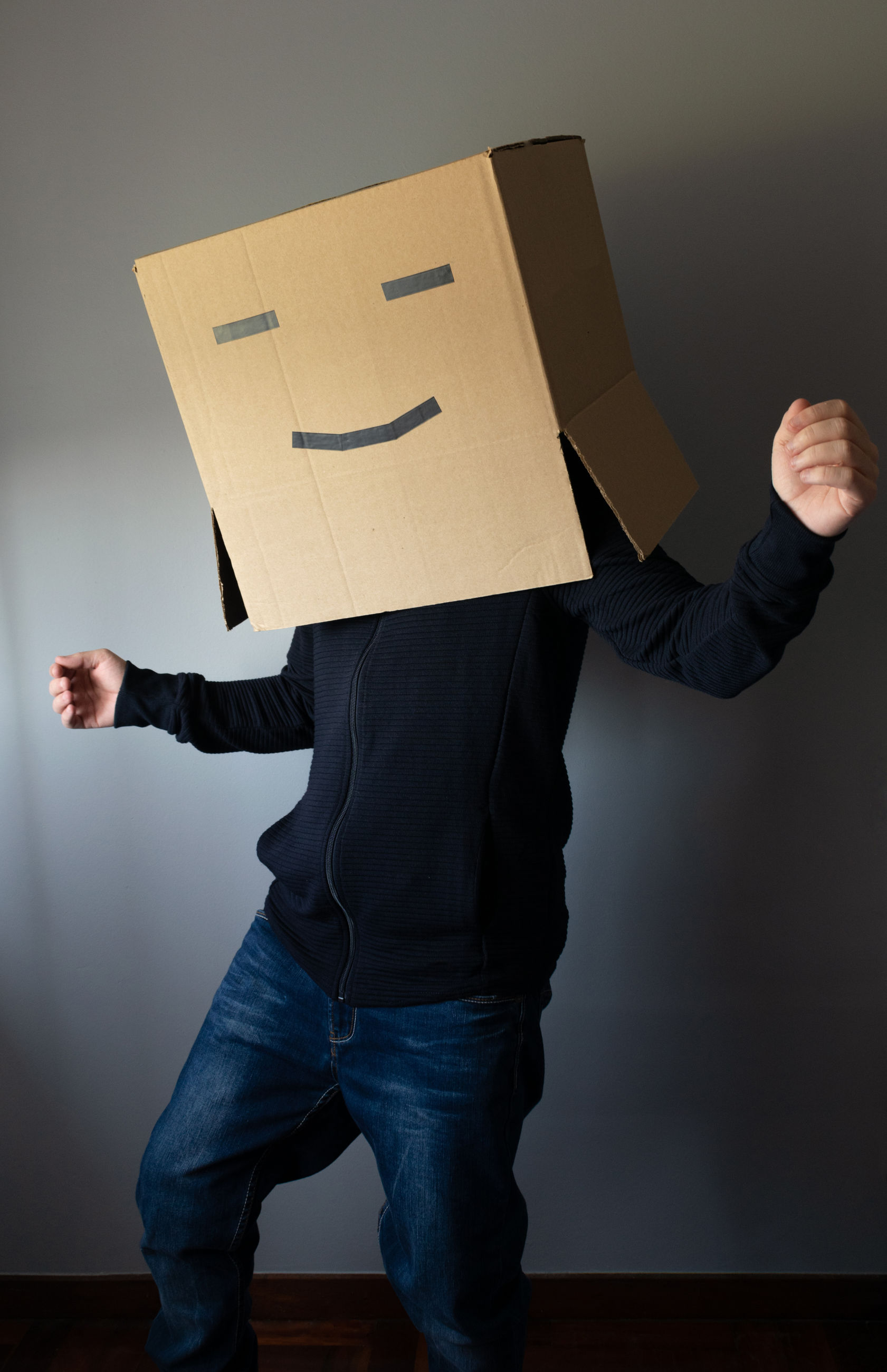 LOW SECTION OF PERSON STANDING ON PAPER WITH ARMS