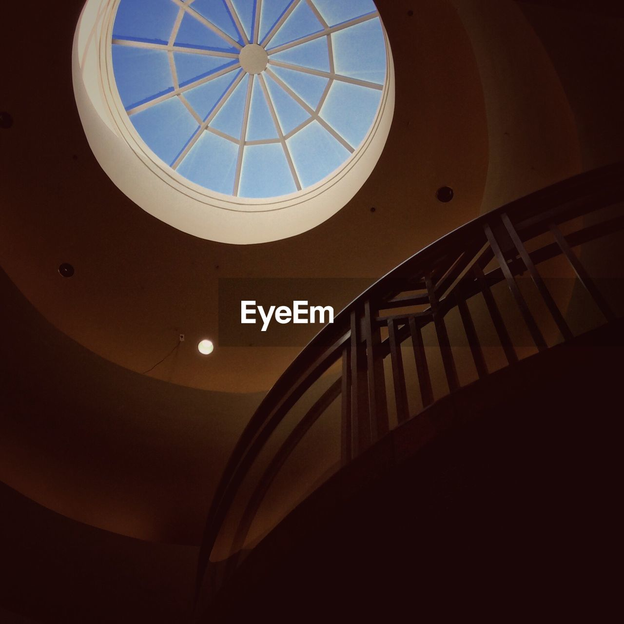architecture, indoors, built structure, low angle view, ceiling, staircase, no people, dome, modern, day