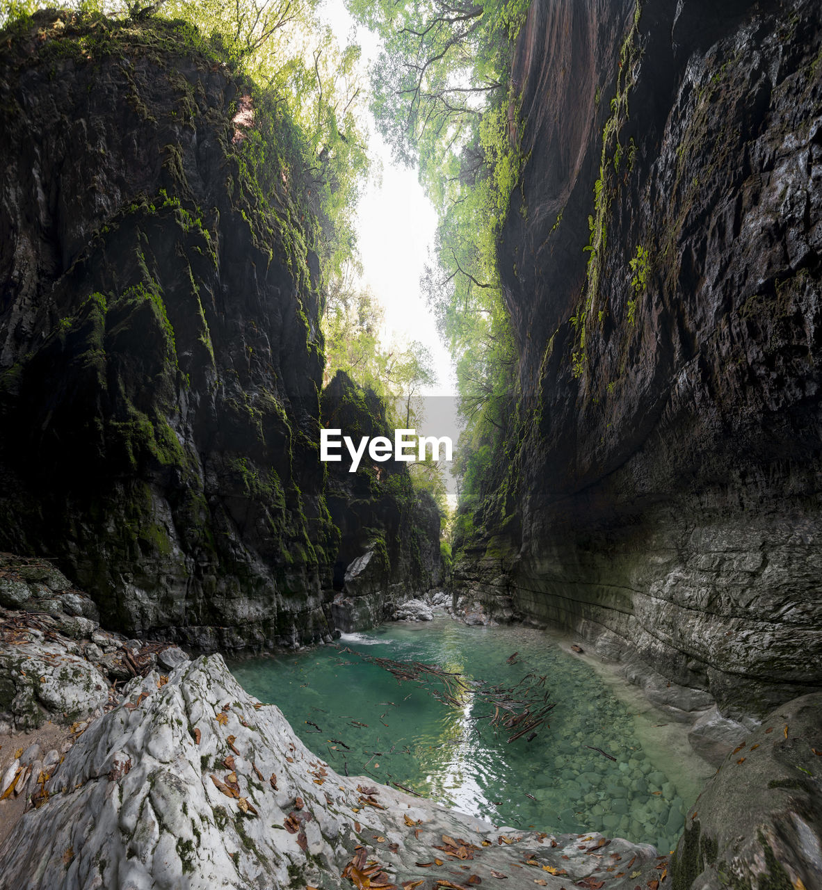 rock, beauty in nature, rock - object, scenics - nature, water, solid, tranquility, plant, mountain, nature, rock formation, tree, day, land, no people, non-urban scene, tranquil scene, outdoors, river, flowing, flowing water, formation