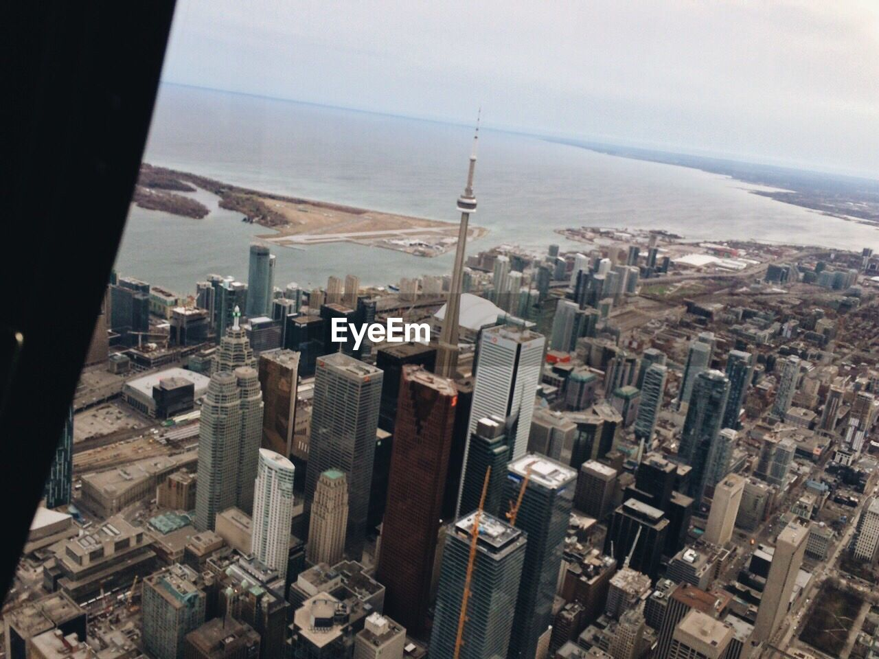 cityscape, city, skyscraper, architecture, sea, crowded, building exterior, day, aerial view, outdoors, sky, built structure, water
