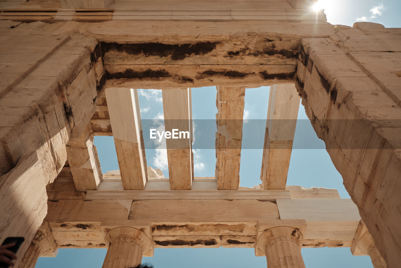 architecture, history, built structure, ancient, the past, architectural column, old ruin, sky, ancient civilization, no people, travel destinations, low angle view, tourism, nature, day, travel, abandoned, archaeology, old, weathered, ruined, outdoors, deterioration, directly below, ancient history, ceiling
