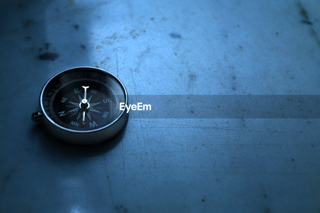 Close-Up Of Compass On Table