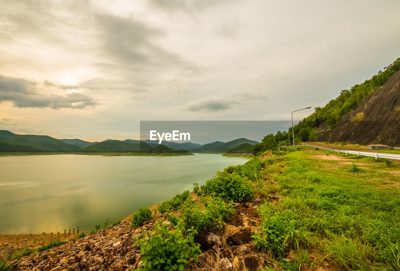 cloud - sky, sky, tranquil scene, tranquility, scenics - nature, beauty in nature, water, nature, plant, non-urban scene, no people, green color, mountain, environment, landscape, lake, tree, day, land, outdoors
