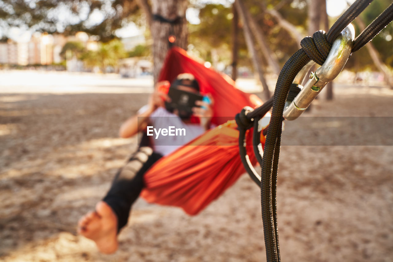CLOSE-UP OF CHILD ON SWING