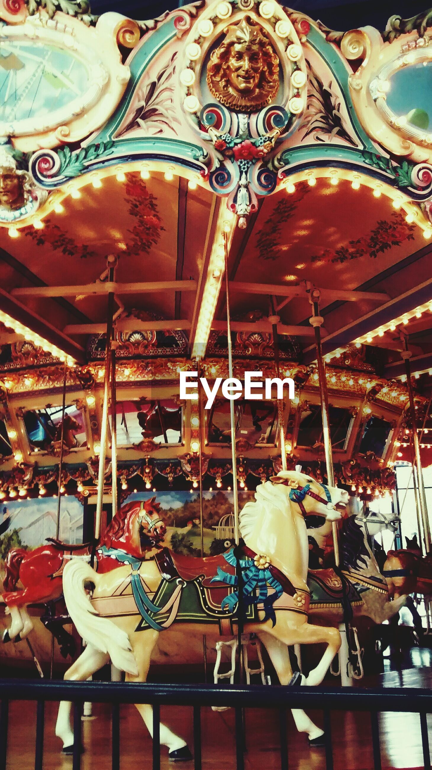 amusement park, art and craft, art, amusement park ride, indoors, creativity, arts culture and entertainment, carousel, decoration, tradition, animal representation, low angle view, retail, cultures, hanging, incidental people, multi colored, built structure, large group of objects, human representation