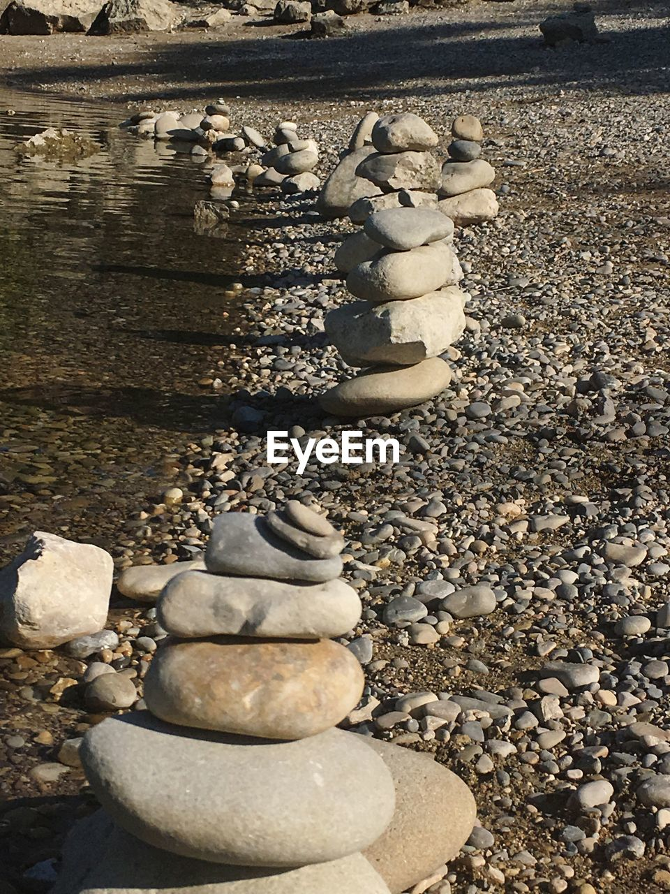pebble, no people, day, outdoors, sculpture, nature, statue, chess, chess piece, close-up