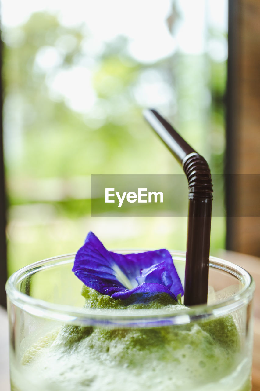 drink, food and drink, freshness, focus on foreground, close-up, glass, household equipment, glass - material, no people, drinking glass, refreshment, nature, day, indoors, food, plant, transparent, table, purple, temptation