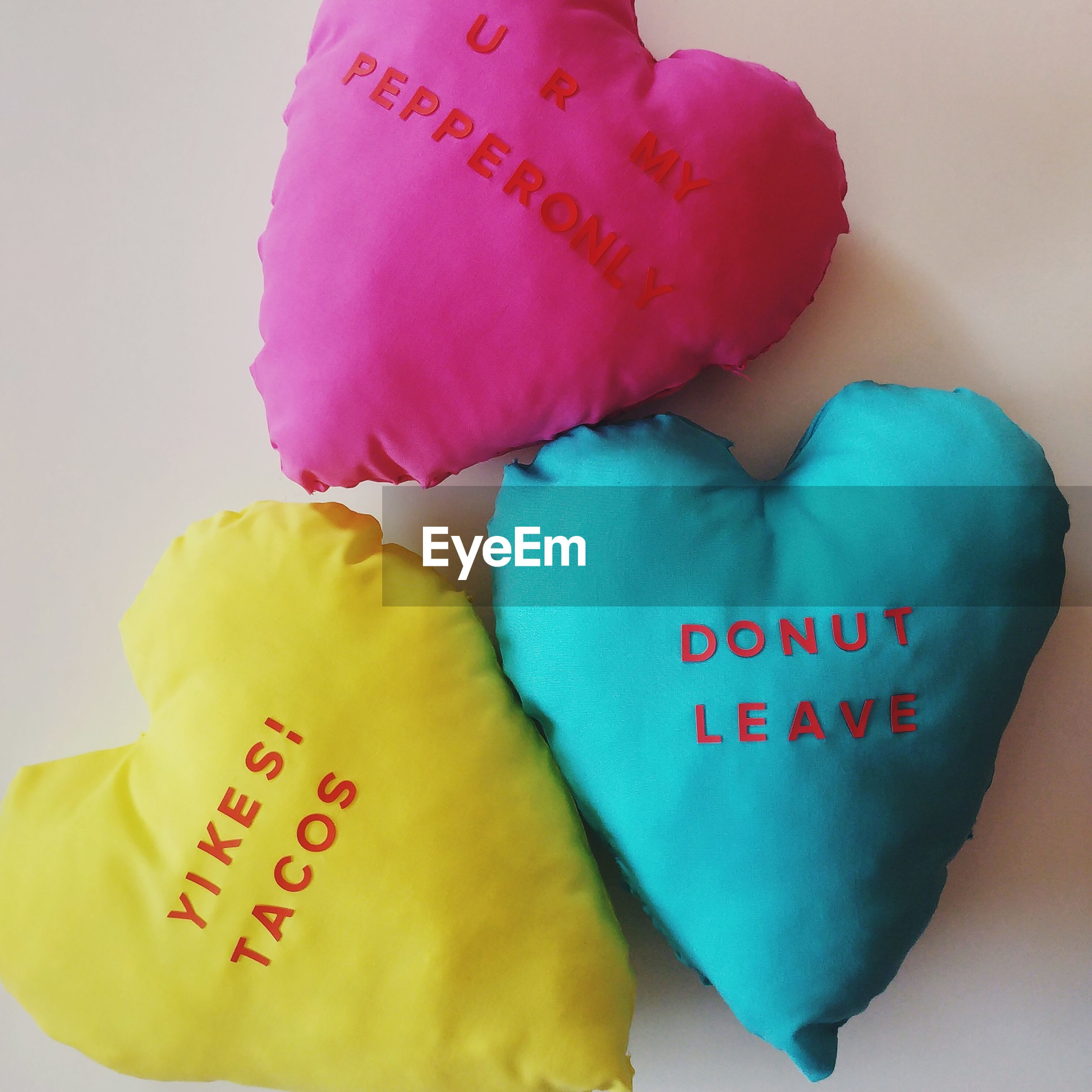 western script, text, message, love, pink color, close-up, heart shape, romance, celebration event, handwriting, indoors, no people, day
