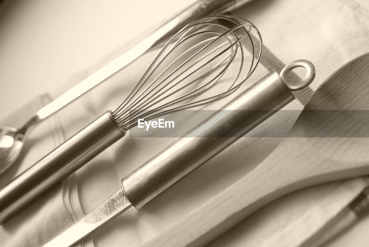 Close-up of kitchen utensils indoors