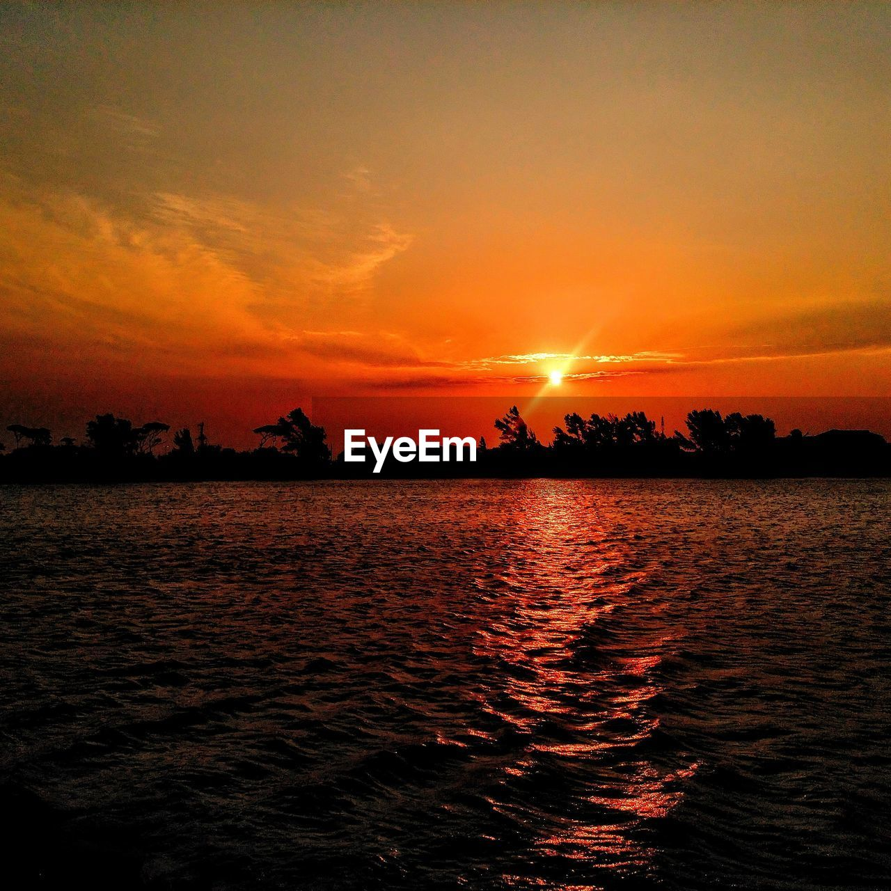 sunset, sky, beauty in nature, orange color, water, scenics - nature, tranquility, tranquil scene, waterfront, sea, silhouette, cloud - sky, idyllic, nature, no people, sun, rippled, outdoors, dramatic sky, romantic sky