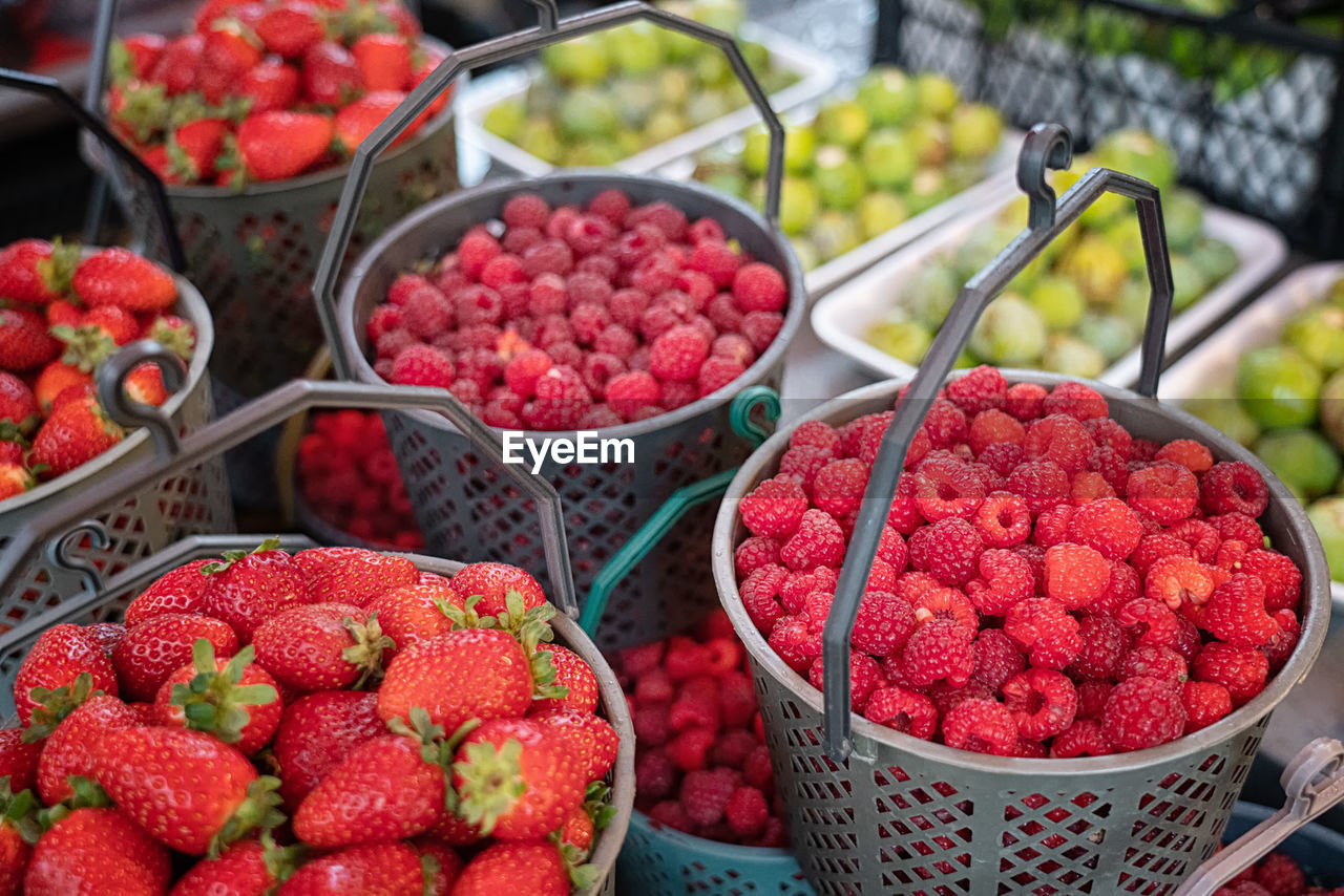 food and drink, food, freshness, red, healthy eating, fruit, wellbeing, berry fruit, for sale, container, retail, market stall, large group of objects, market, strawberry, abundance, day, no people, high angle view, choice, sale, retail display, outdoors, ripe, consumerism