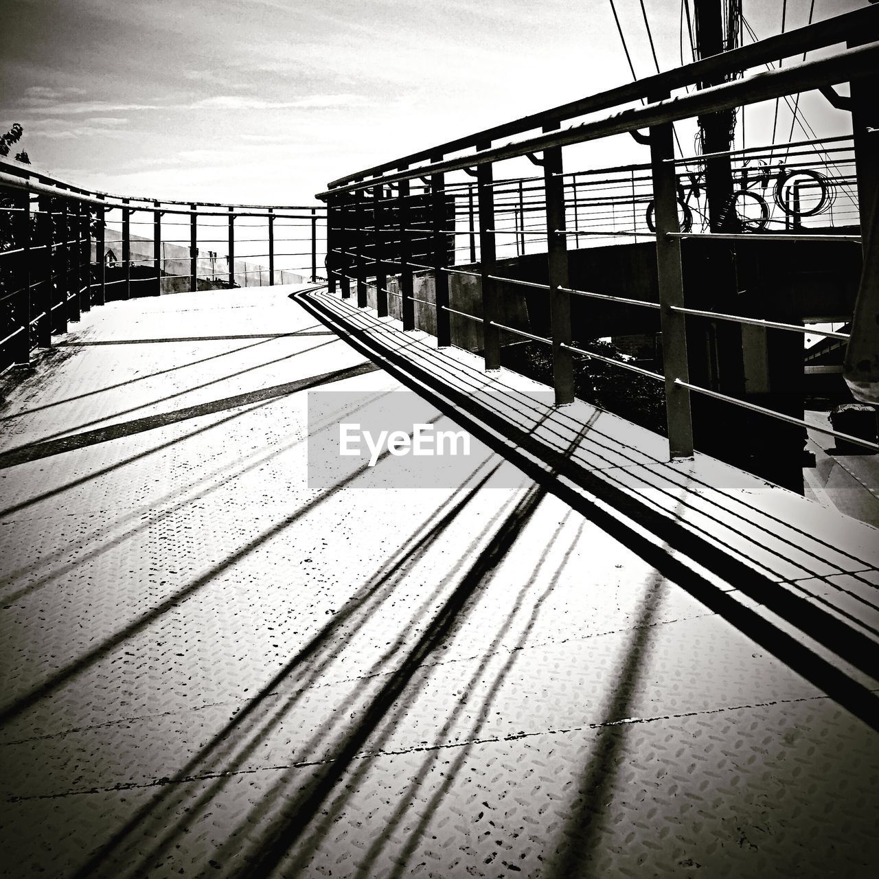 rail transportation, railing, transportation, connection, built structure, railroad track, no people, bridge - man made structure, day, sky, outdoors, architecture, public transportation, train station