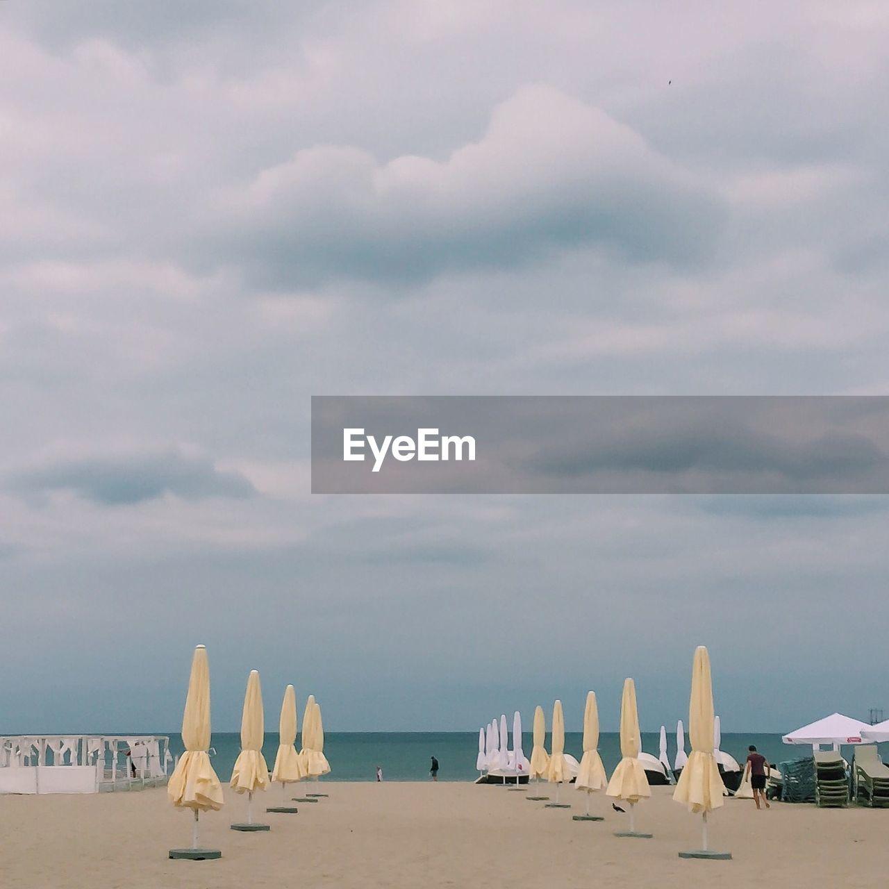 Closed beach umbrellas on beach