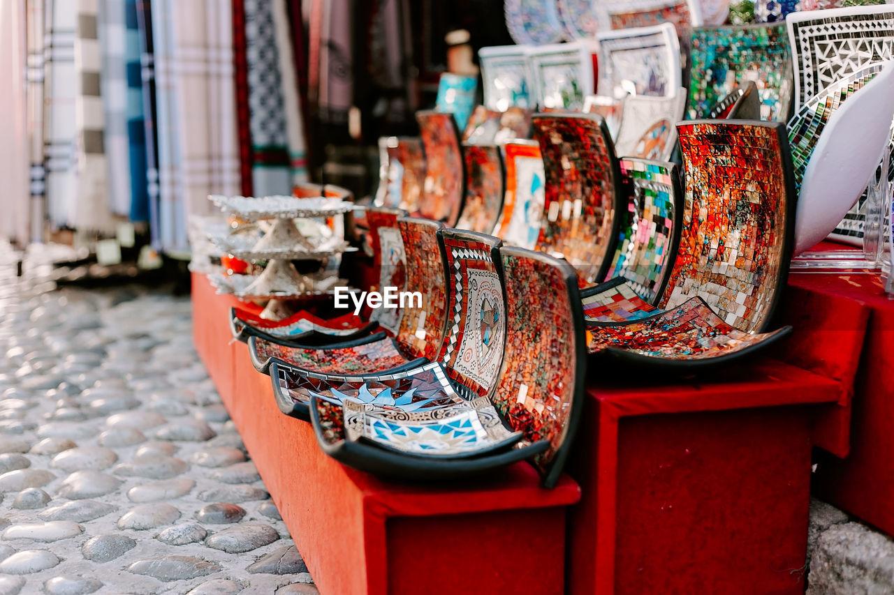 Close-up of multi coloured ceramics on table