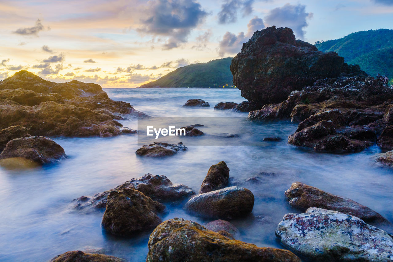 rock, rock - object, water, sea, solid, beauty in nature, sky, scenics - nature, cloud - sky, motion, long exposure, sunset, land, beach, nature, no people, tranquility, tranquil scene, idyllic, horizon over water, outdoors, rocky coastline