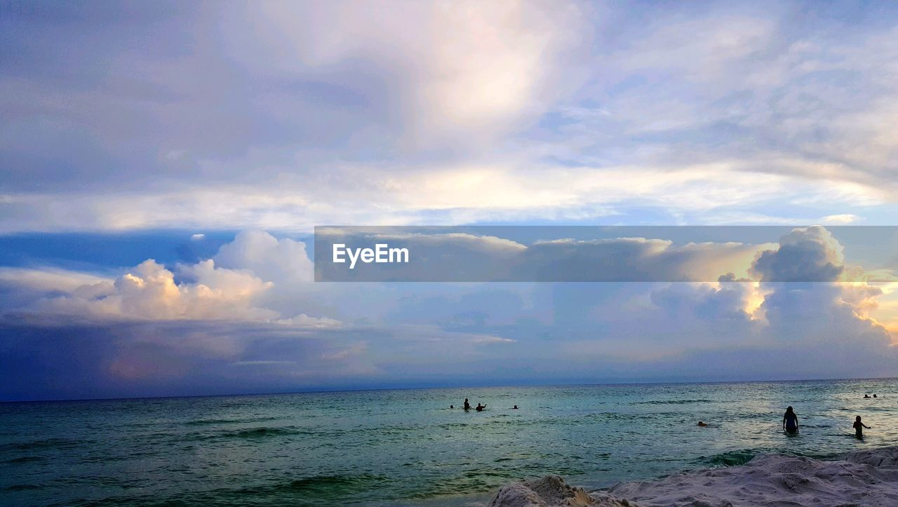 sky, sea, cloud - sky, water, horizon over water, horizon, land, scenics - nature, beach, beauty in nature, nature, tranquility, outdoors, tranquil scene, real people, leisure activity, day, unrecognizable person, holiday
