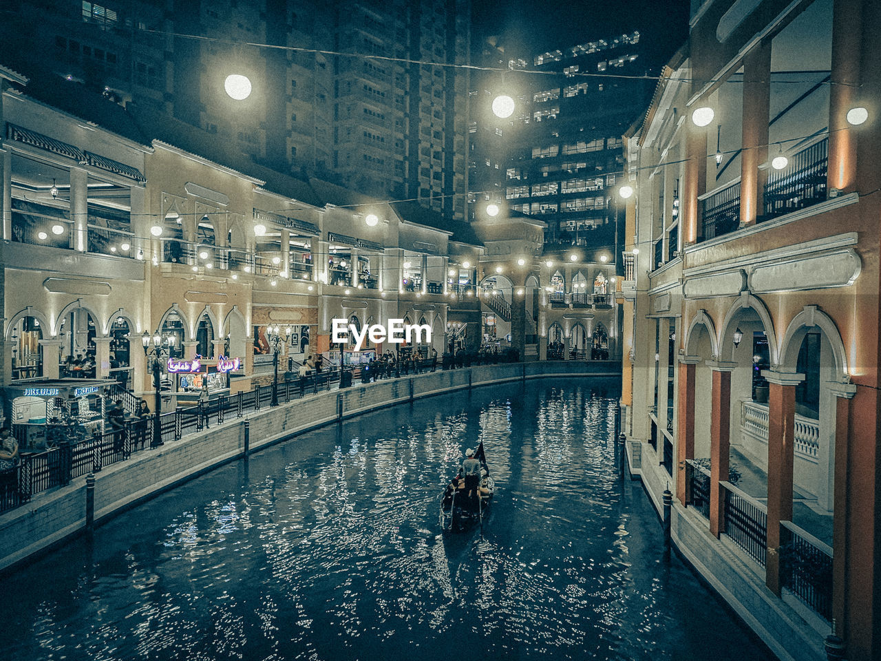 water, architecture, building exterior, built structure, illuminated, city, night, transportation, waterfront, nature, real people, incidental people, people, street light, nautical vessel, building, street, mode of transportation, lifestyles, canal, swimming pool, nightlife