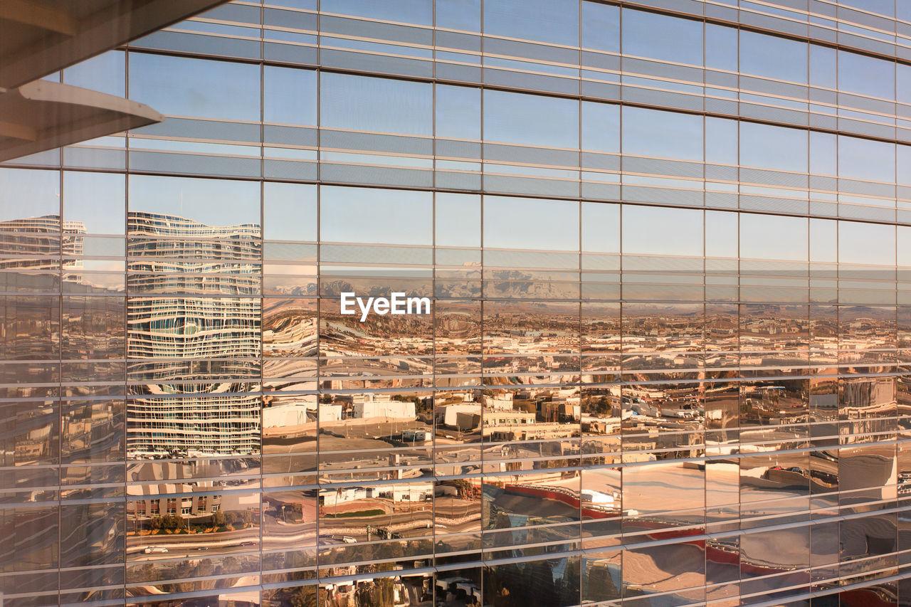 Full frame shot of city reflection in glass
