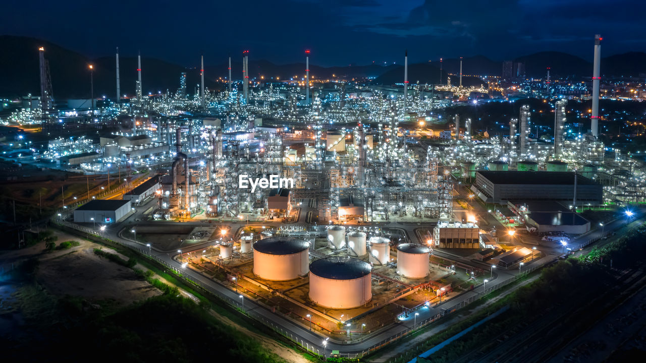 Oil and gas refinery industry for transport and export of thailand aerial view at night shot