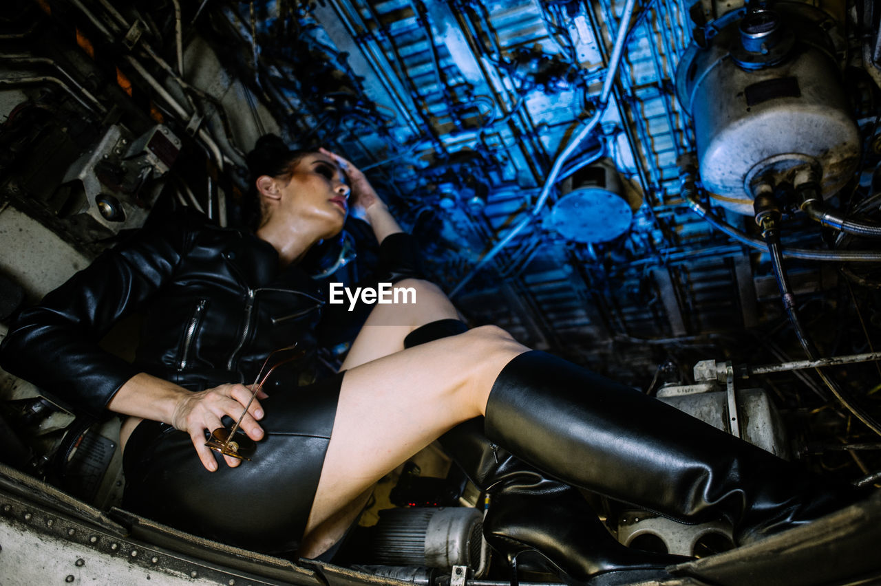 Woman sitting by engine in airplane