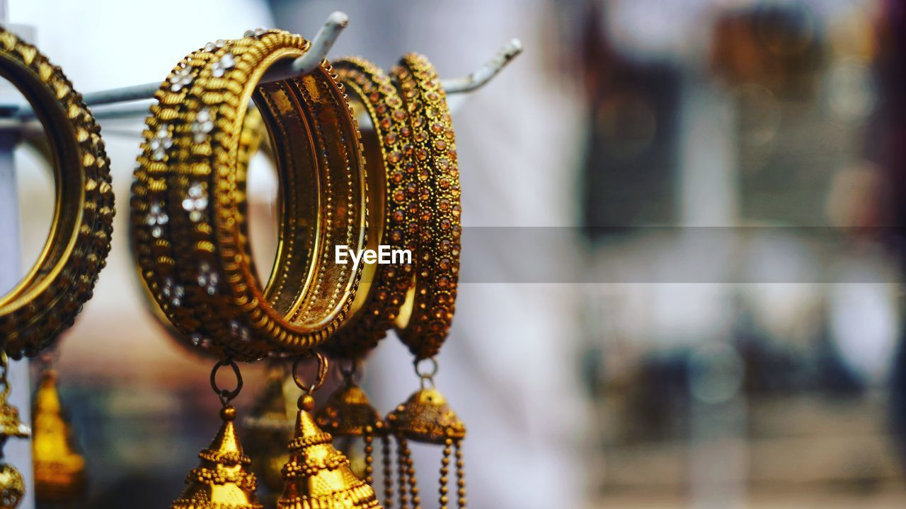 Close-up of bangles hanging for sale at store