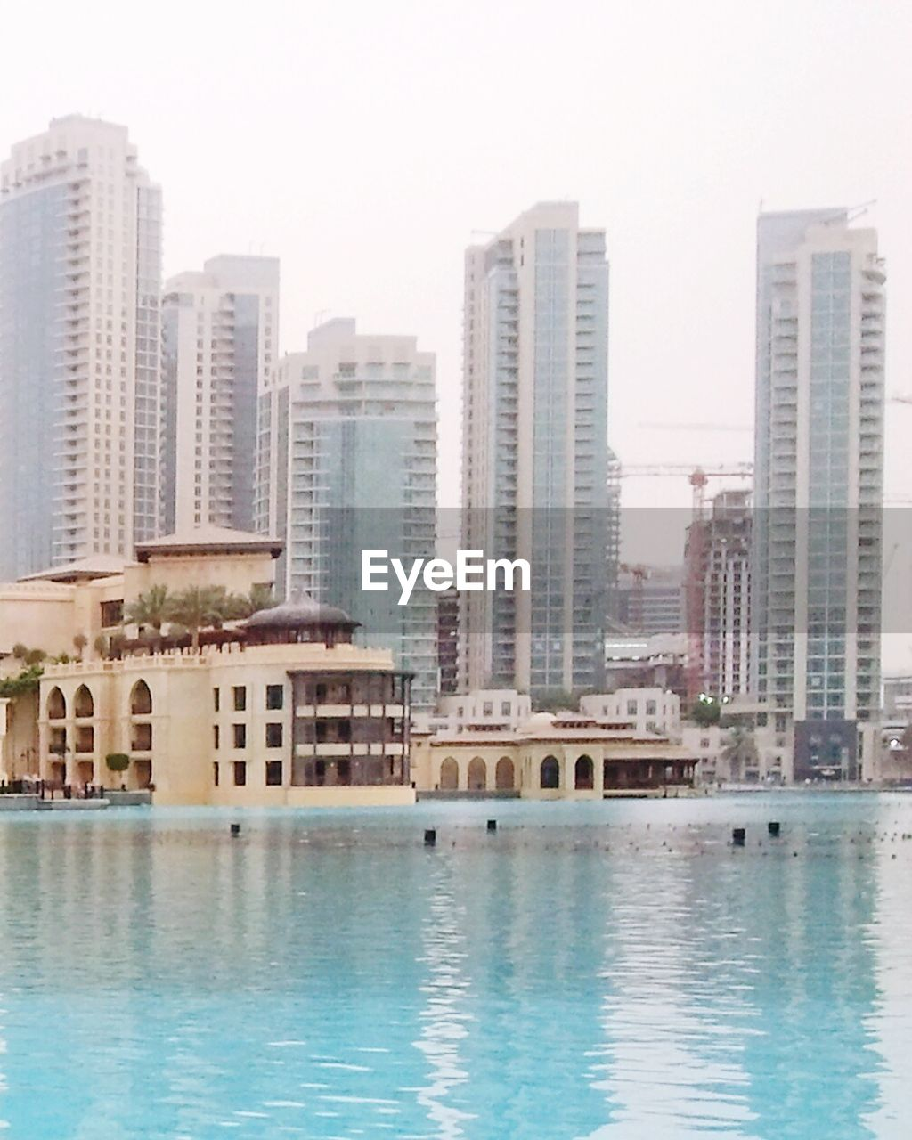 water, architecture, building exterior, swimming pool, built structure, waterfront, skyscraper, clear sky, luxury, day, modern, outdoors, luxury hotel, no people, city, sea, cityscape, sky