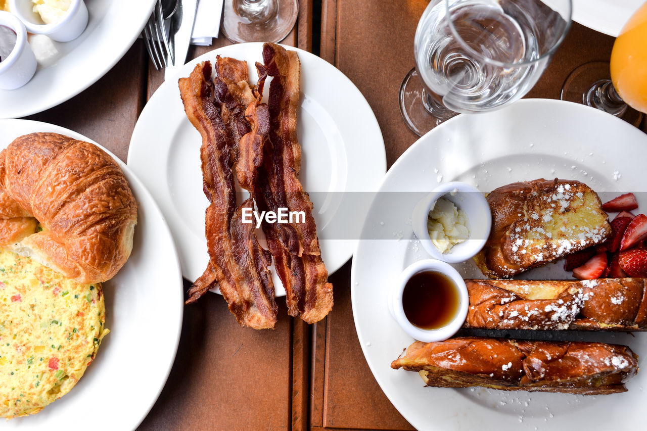 food and drink, food, table, meat, freshness, ready-to-eat, plate, meal, indoors, serving size, still life, healthy eating, high angle view, glass, no people, pork, directly above, wellbeing, drinking glass, close-up, fried, breakfast