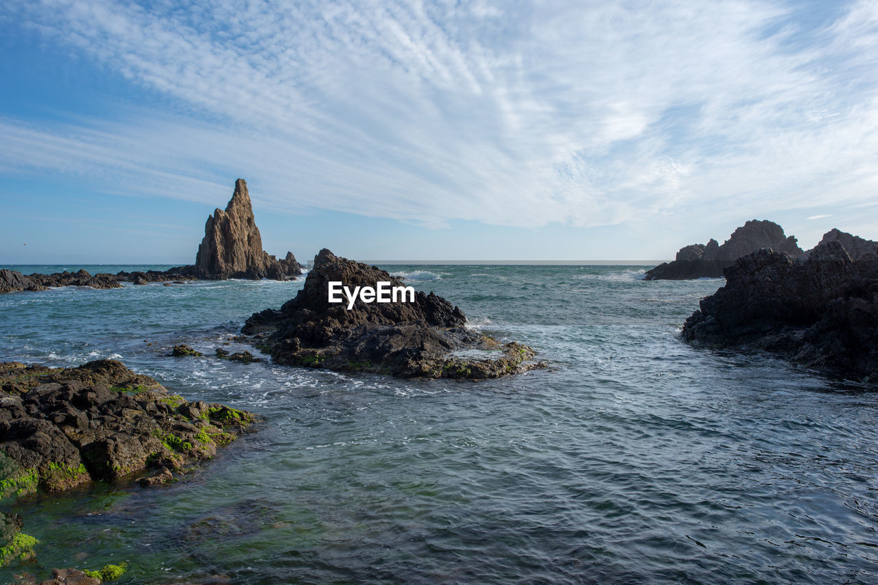 sea, water, sky, rock, scenics - nature, beauty in nature, solid, rock - object, horizon over water, horizon, motion, land, tranquil scene, tranquility, beach, rock formation, no people, nature, cloud - sky, outdoors, rocky coastline, stack rock, eroded