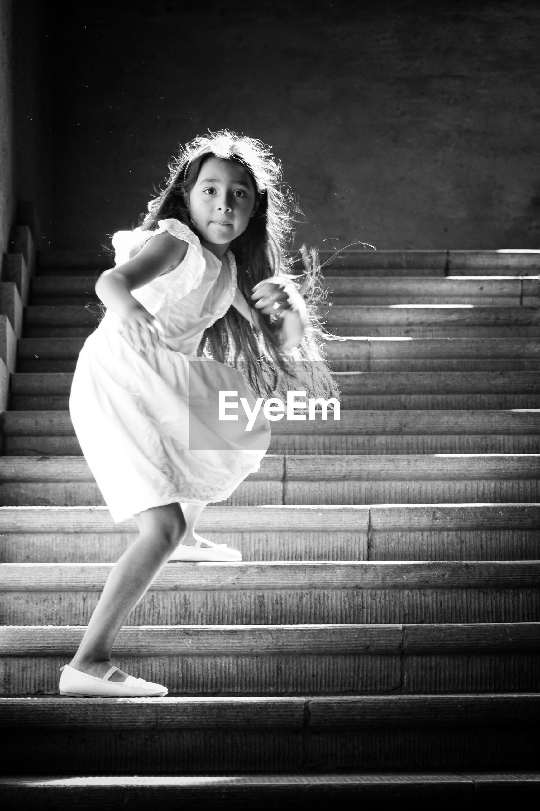 Portrait of girl standing on steps