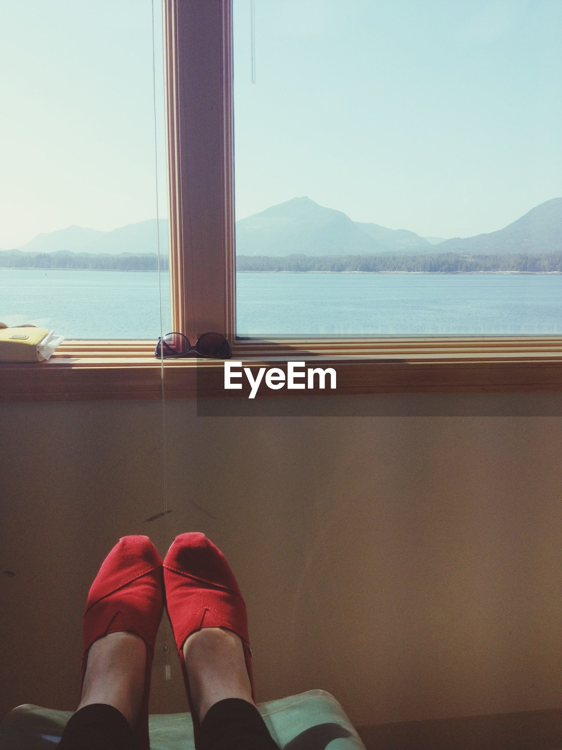 low section, person, water, mountain, personal perspective, sea, shoe, clear sky, human foot, lifestyles, lake, relaxation, mountain range, leisure activity, sky, tranquility, scenics
