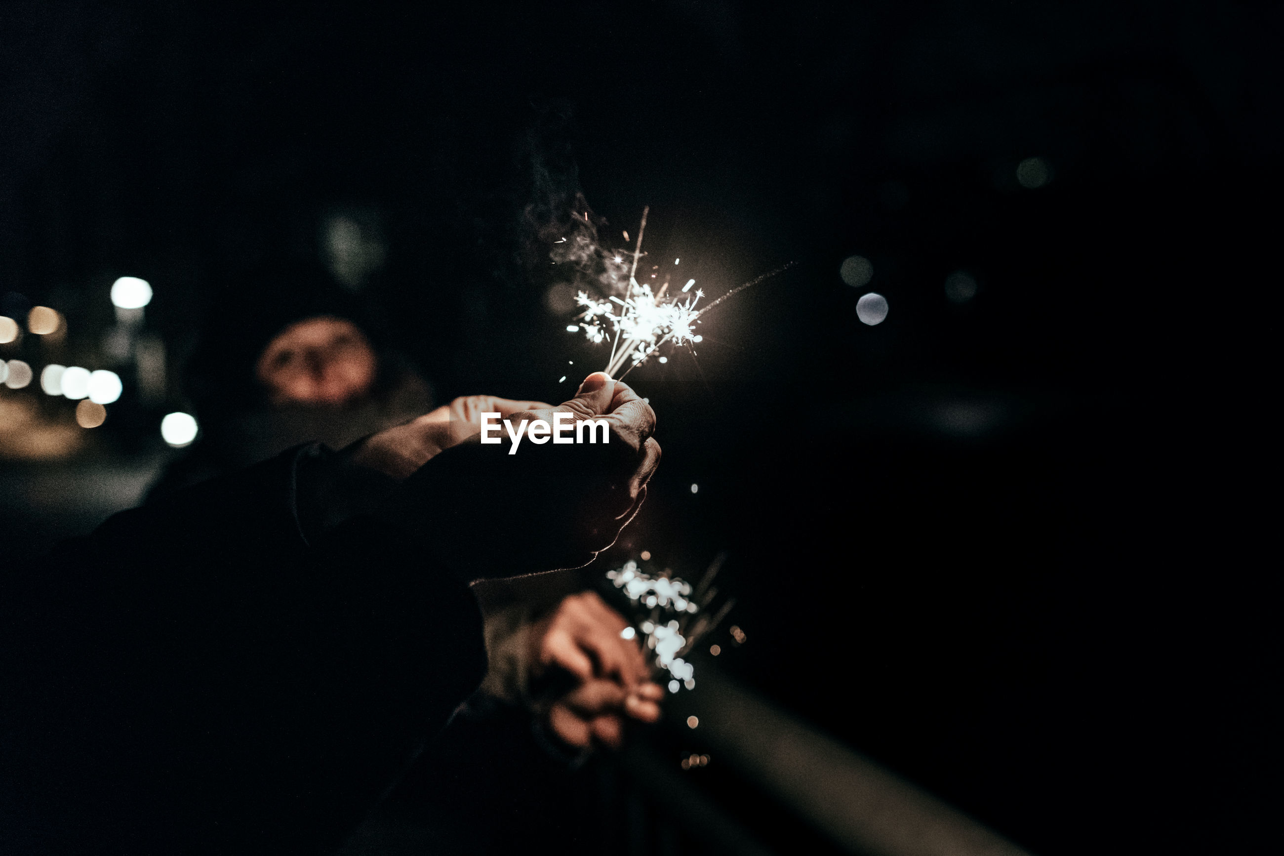 Close-up of sparklers in human hand