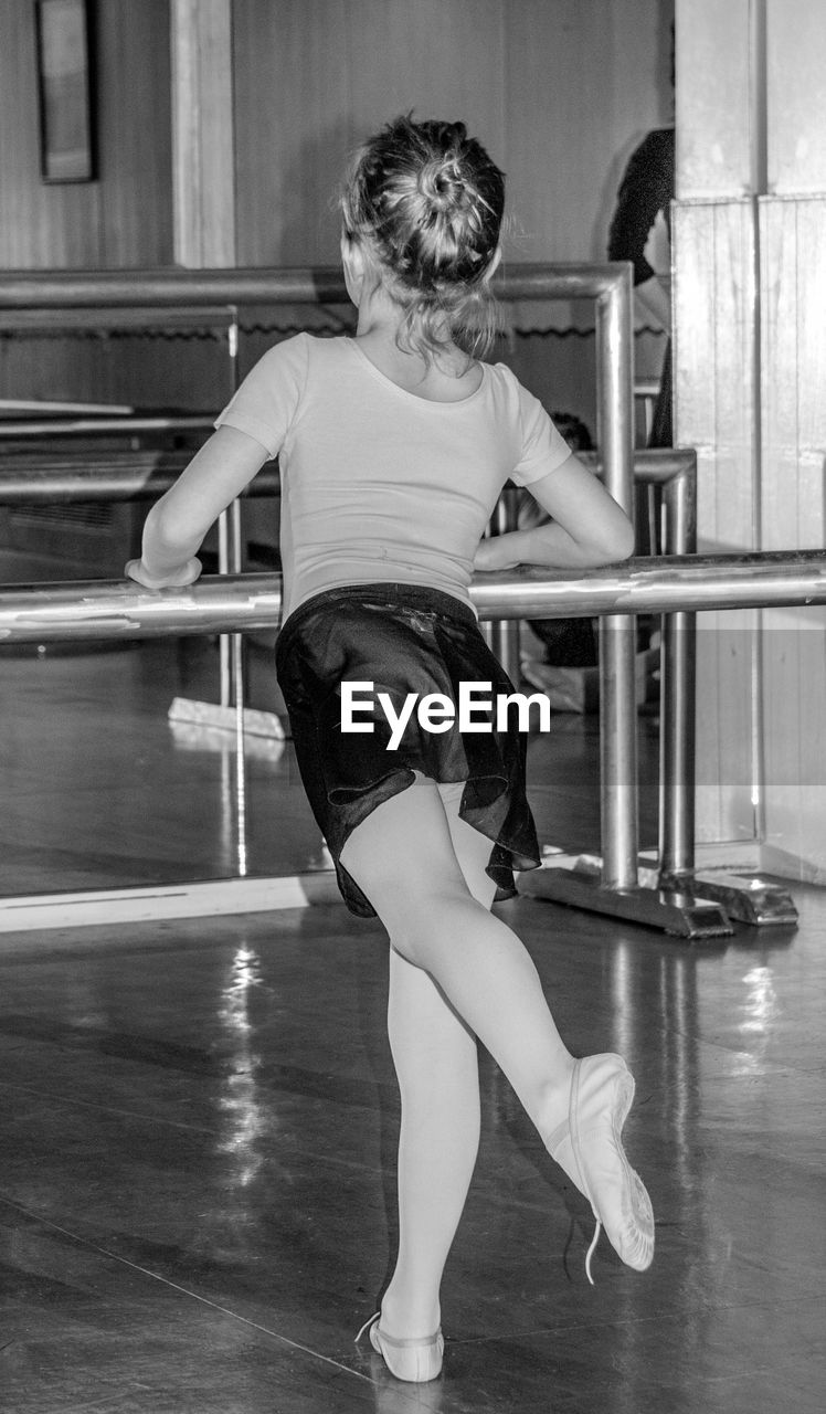 Rear View Of Girl Dancing Ballet In Studio