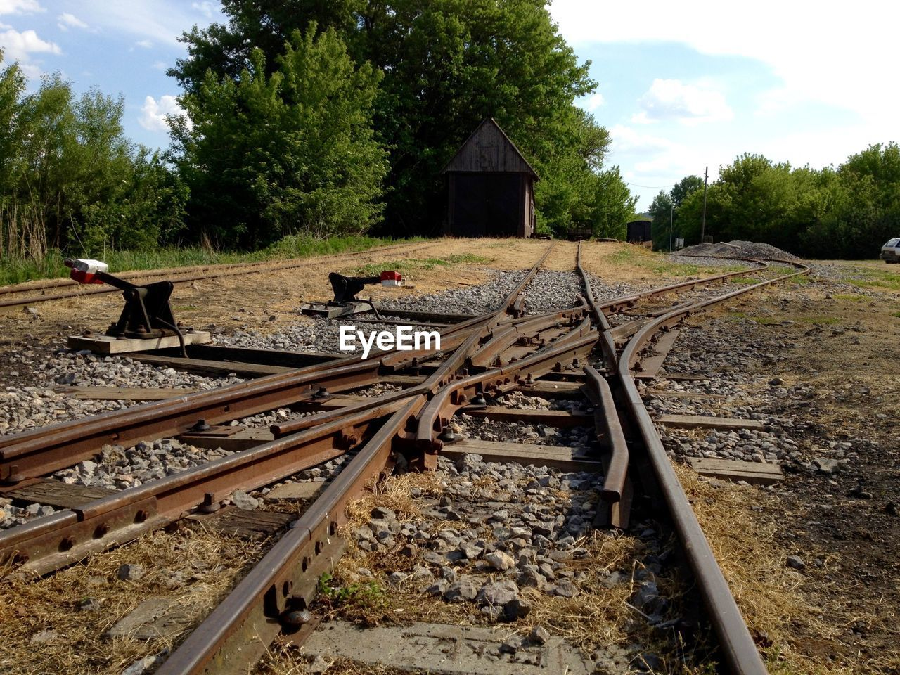 Railroad intersection in shunting yard against sky