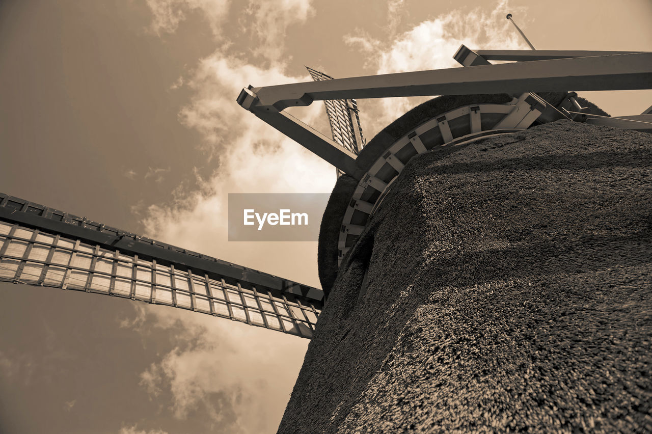 alternative energy, low angle view, built structure, renewable energy, sky, cloud - sky, architecture, outdoors, wind power, wind turbine, fuel and power generation, windmill, day, no people, nature, traditional windmill