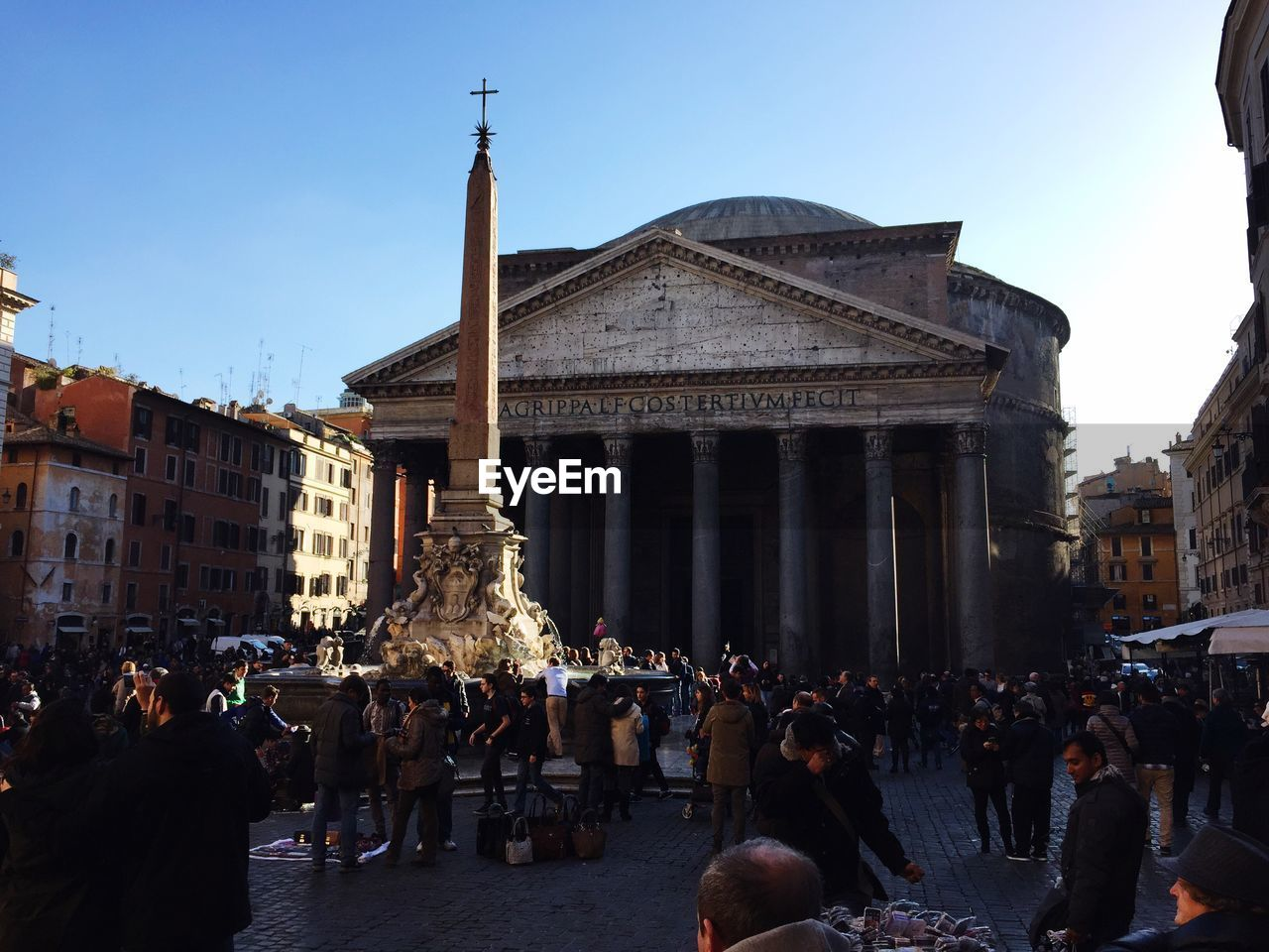 large group of people, architecture, built structure, building exterior, real people, history, women, statue, travel destinations, tourism, men, sculpture, outdoors, travel, mixed age range, leisure activity, lifestyles, crowd, day, architectural column, sky, clear sky, people