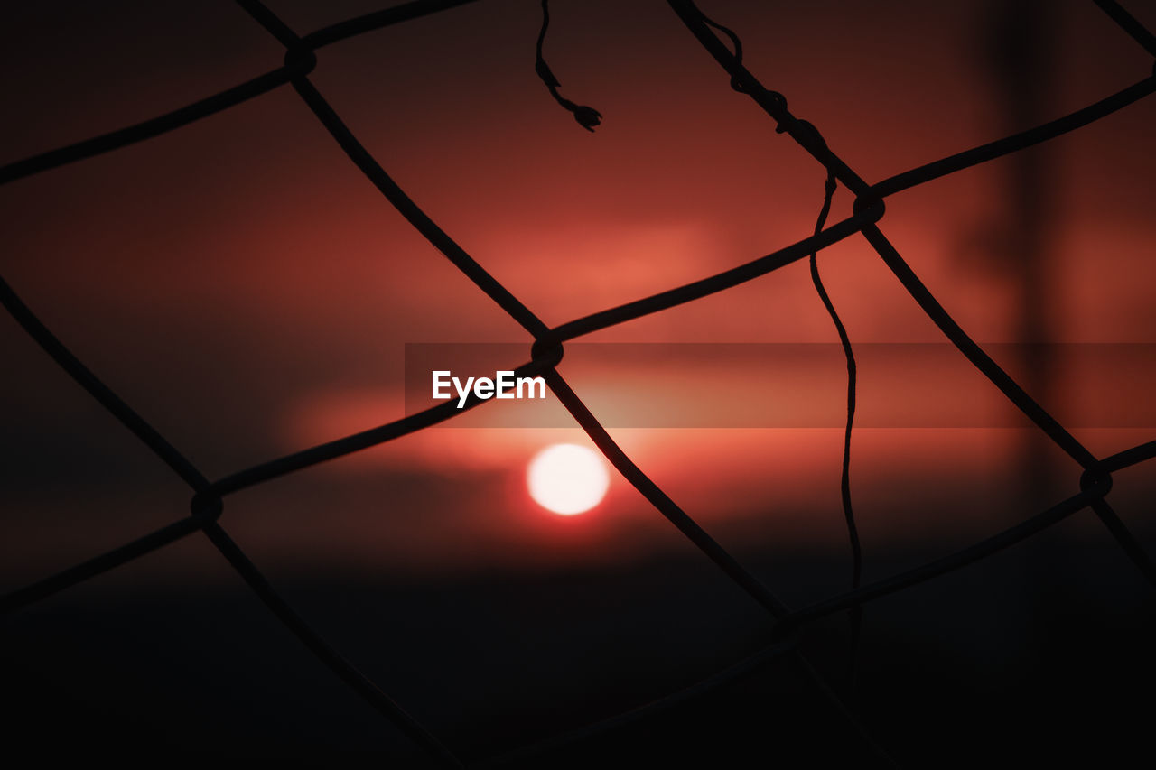 sunset, sky, fence, no people, orange color, nature, sun, beauty in nature, silhouette, metal, barrier, boundary, backgrounds, close-up, safety, protection, full frame, security, chainlink fence, outdoors