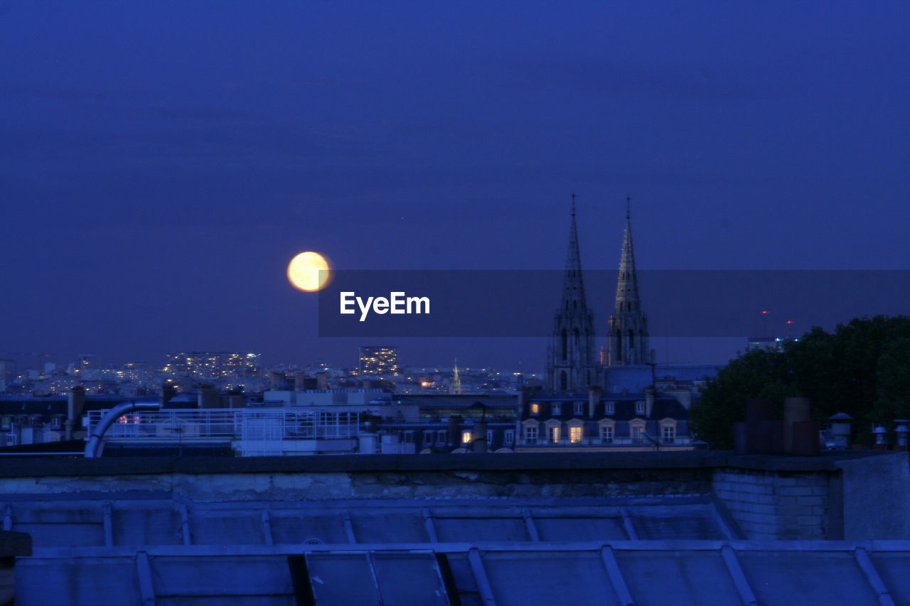 moon, architecture, built structure, building exterior, night, outdoors, city, blue, sky, clear sky, no people, illuminated, nature, cityscape, astronomy