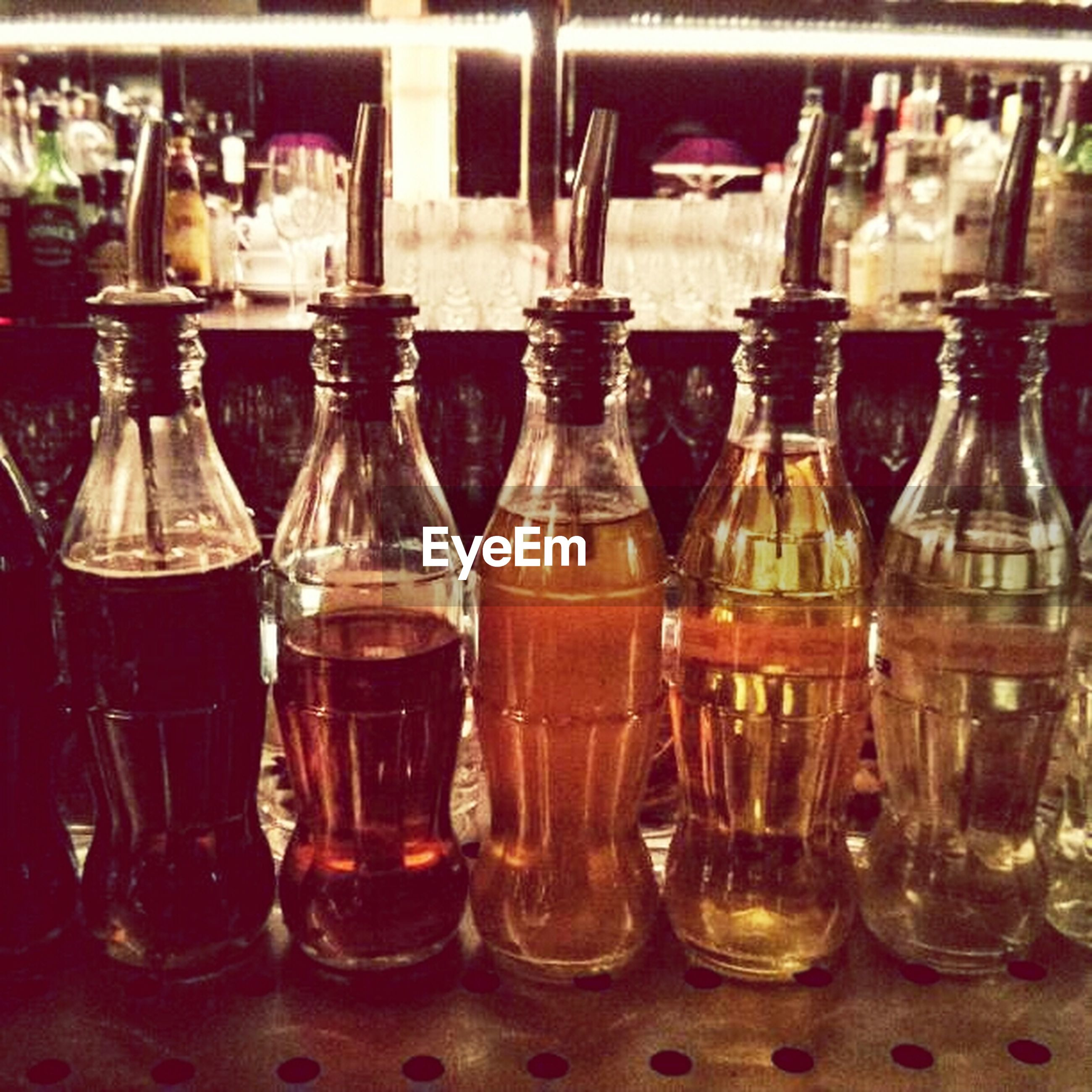 food and drink, indoors, drink, refreshment, drinking glass, still life, freshness, glass - material, table, close-up, transparent, alcohol, food, glass, bottle, jar, healthy eating, focus on foreground, restaurant, in a row