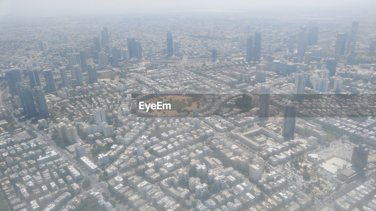 cityscape, architecture, city, building exterior, built structure, aerial view, crowded, skyscraper, outdoors, day, travel destinations, modern