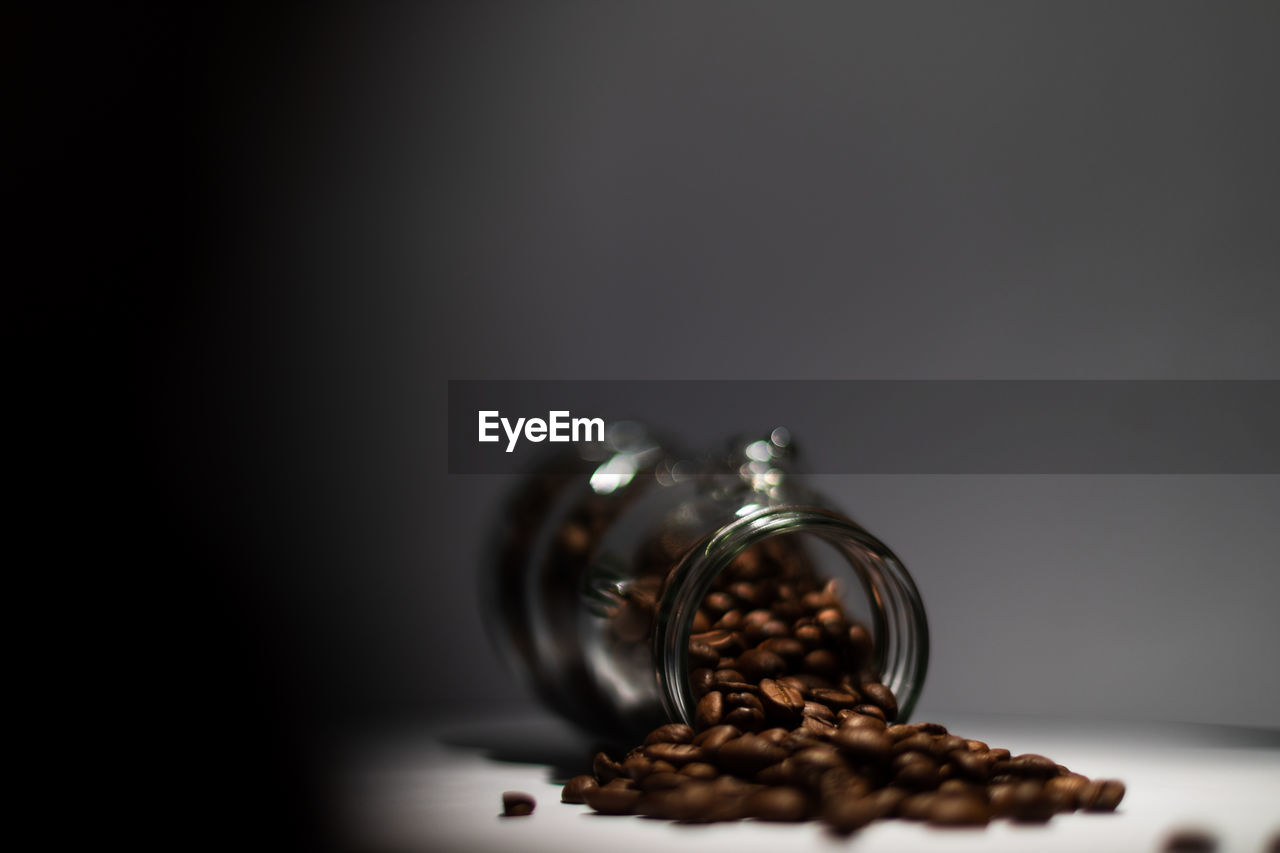 still life, indoors, selective focus, food and drink, table, close-up, roasted coffee bean, no people, food, copy space, coffee, coffee - drink, brown, freshness, studio shot, coffee bean, glass - material, transparent, container, large group of objects, temptation