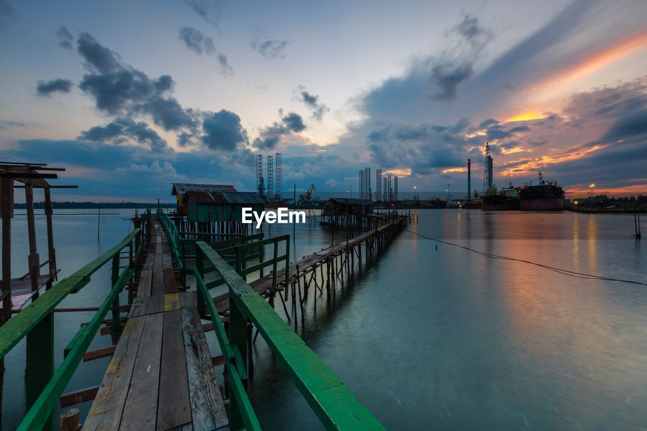 sky, cloud - sky, built structure, industry, water, sunset, oil industry, architecture, outdoors, sea, factory, nature, no people, scenics, building exterior, beauty in nature, day