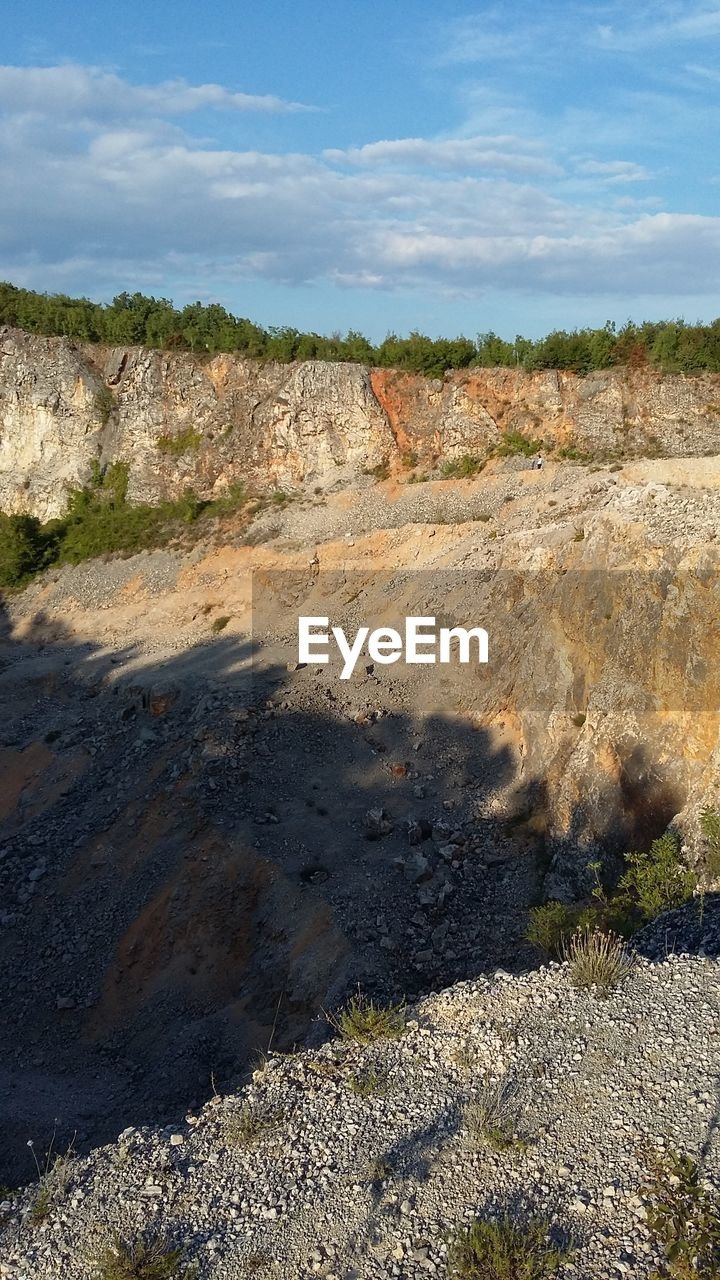 nature, sky, land, day, environment, sunlight, landscape, no people, cloud - sky, non-urban scene, scenics - nature, industry, outdoors, shadow, beauty in nature, field, physical geography, tranquil scene, tranquility, geology, quarry