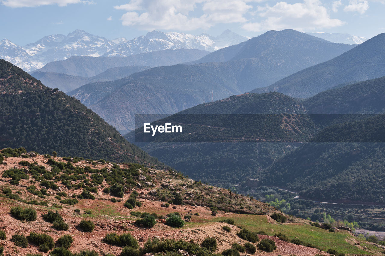 mountain, environment, landscape, scenics - nature, beauty in nature, mountain range, tranquil scene, sky, nature, no people, tranquility, non-urban scene, land, outdoors, cloud - sky, valley, remote, day, plant, mountain peak, high, range