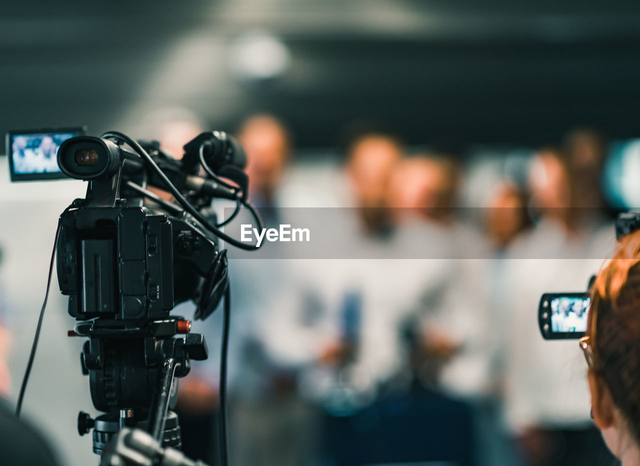 Video camera against people in event