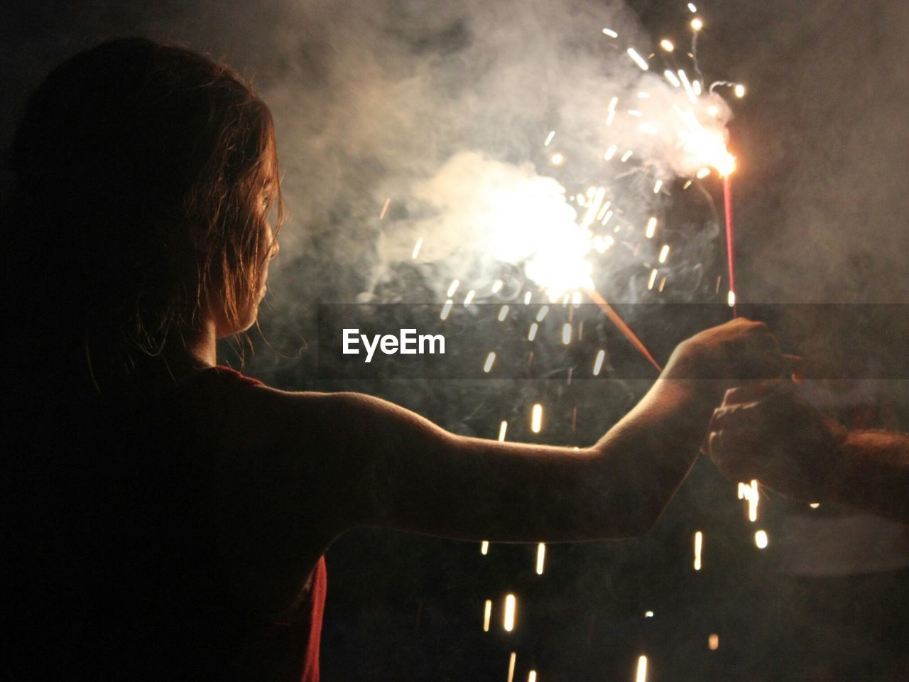 People Celebrating With Firecracker At Night