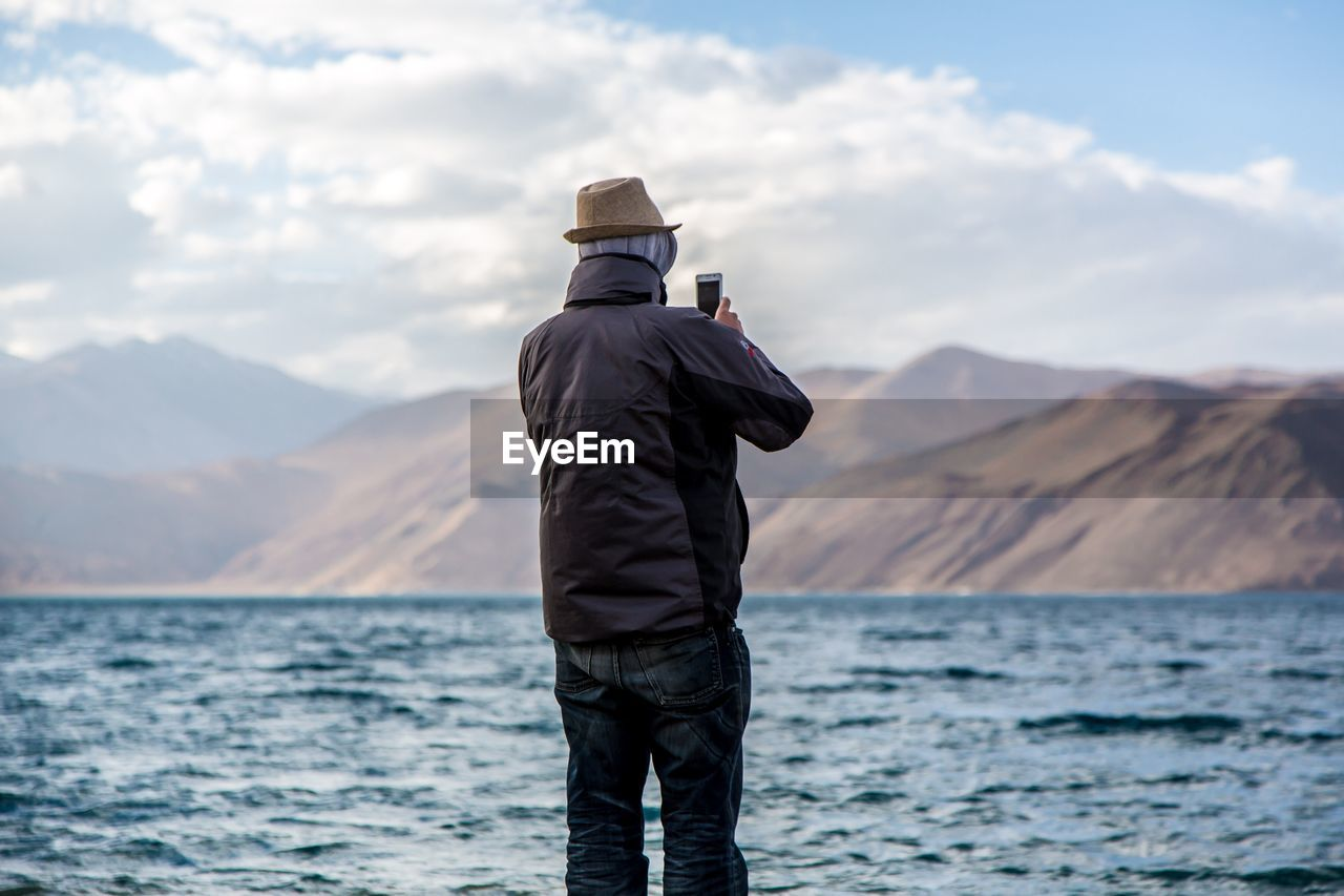Man Photographing Mountains