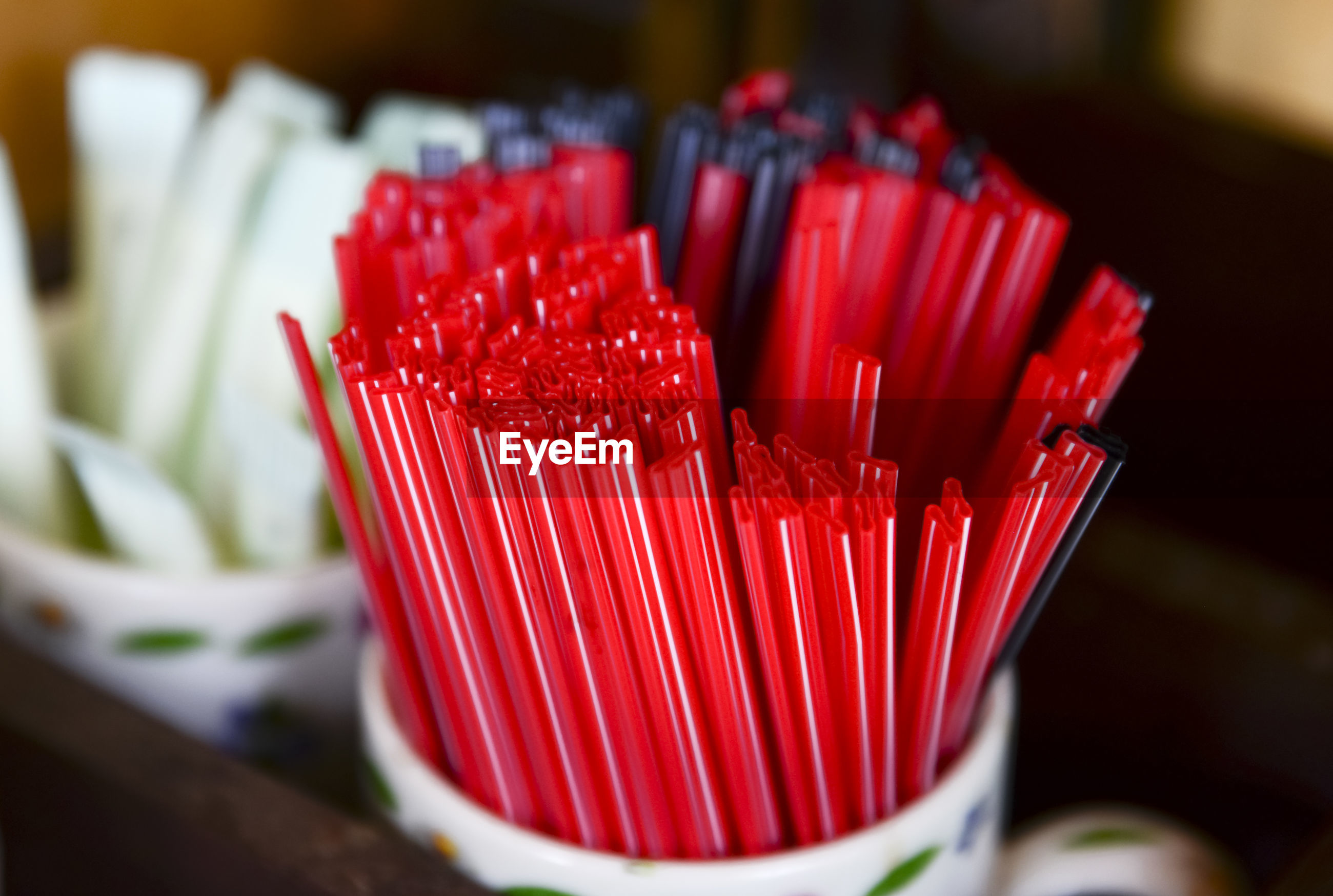 Close-up of red drinking straws