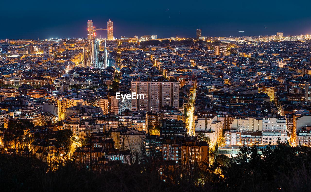 High angle view of city lit up at night. sagrada familia lit up.